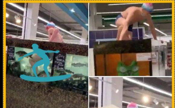 """В одному з супермаркетів пранкер у """"костюмі плавця"""" викупався в акваріумі з живою рибою. ВІДЕО"""