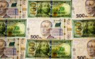 Долар і євро падають третій день поспіль