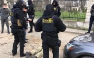 Затримали військового, який вимагав 180 тисяч грн за невідправлення в ООС
